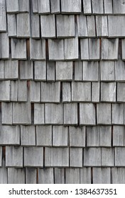 Backgrounds and textures: weathered wooden shingles, exterior wall or roof of rustic building
