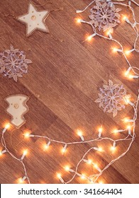 Backgroung of christmas garland lights on the wooden floor
