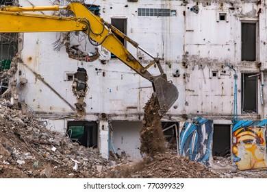 Backhoe Demolishes Old Buildings.