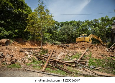 backhoe to excavate the soil on the ground On the Moutain