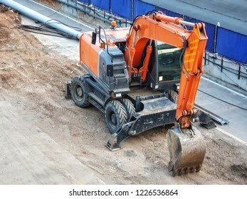 backhoe to excavate the soil on the ground.construction site excavator.wheelloader