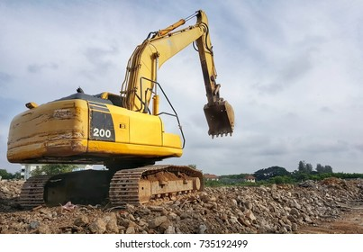 backhoe to excavate the soil on the ground.construction site excavator.wheelloader.