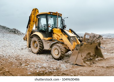 Backhoe excavator and bulldozer on construction site