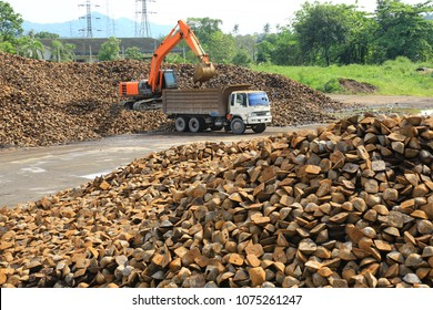 a backhoe ,loading pig iron from pile to ten wheeler truck and transfer to scrap bay or scrap bucket