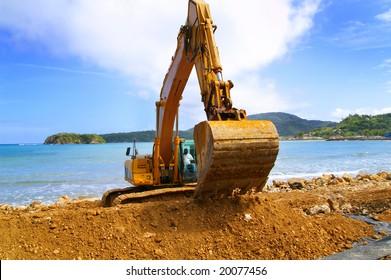 backhoe moving soil