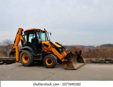 Backhoe on road. Loader excavator with backhoe.