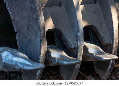 Backhoe scoop shovel bucket abstract with newly welded teeth