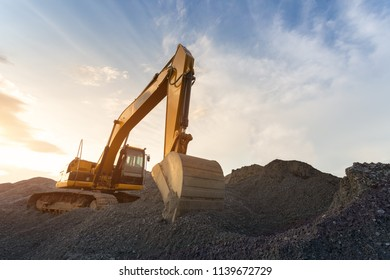 Backhoe used in construction, Big excavator on new construction site, in the background the blue sky and sun.