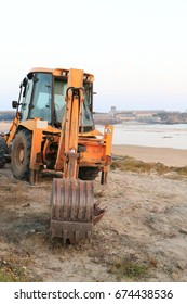 Backhoe working on the beach