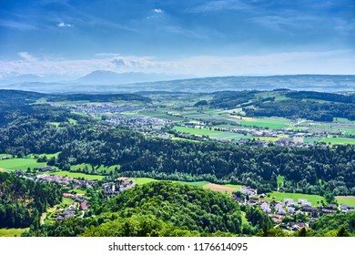"Backlands and woods of Zurich in Switzerland / View over Cantons of ""Aargau"" and ""Zug"" with alps in the background"