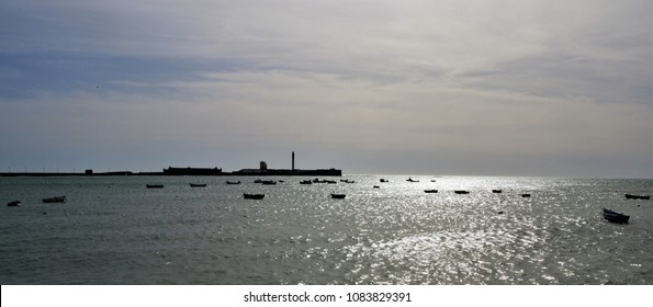 backlight with boats stranded in the bay of Cádiz, spain,