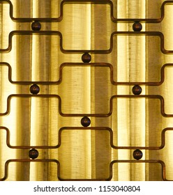 A backlight with curtains and a geometric pattern with metal squares and circles.