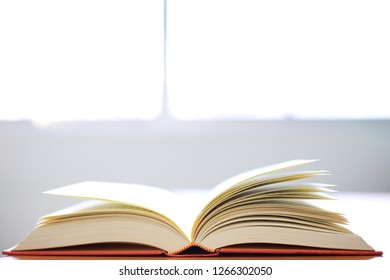 Backlight of open book on desk selective focus and shallow depth of field