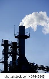 Backlight petrochemical industry smog smoke on sky