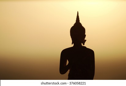 Backlight silhouette of Buddha statues in the temple