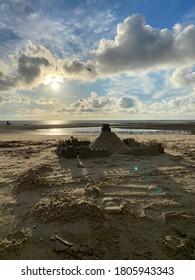Backlight of the sun on sand castle on Wimereux beach, Opal coast