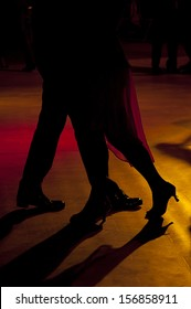 Backlighting of the legs of two tango dancers