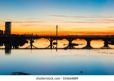 backlighting Real bridge and Guadianas River in sunlate, Badajoz, Extremadura, Spain