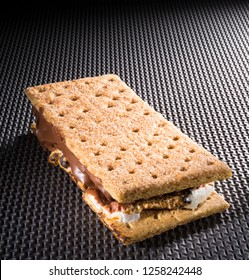 Backlit camping smore on a rubber and textured background