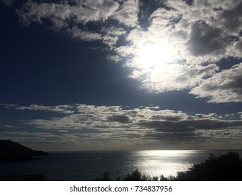 Backlit clouds over the sea