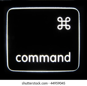 A backlit Command button isolated on a black background