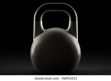 Backlit competition kettlebell silhouette on a fitness studio gym floor with potential text space on kettlebell