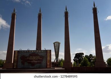 Backlit granite pillars and Altyn Shanyrak monument in Independence Park Shymkent, Kazakhstan - September 11, 2016