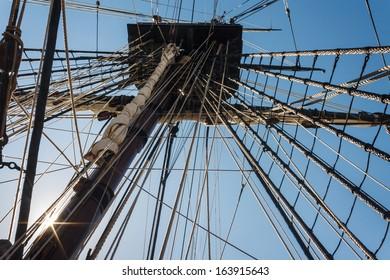 backlit mainmast of replica ship