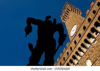 backlit of Perseus with the Head of Medusa 1545 of Benvenuto Cellini, with the Palazzo Vecchio in the background, Florence