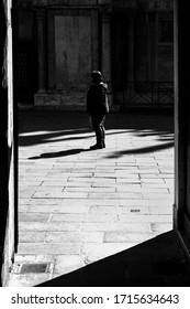 Backlit person in Venice center