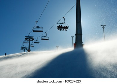 backlit scenes with ski lift chairs on hillside, Levi ski resort, Finland