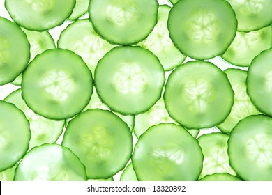 Backlit slices of cucumber for textured background