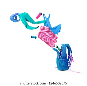 Backpack with colorful things that fly out of it, isolated on a white background