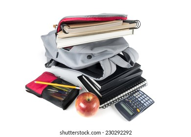 Backpack full of school supplies. on white background.
