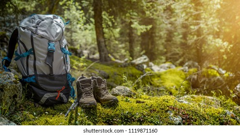 Backpack and hiking boots in forest