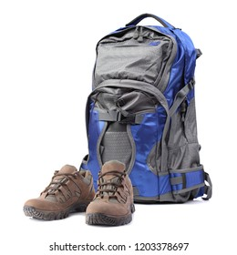 Backpack and hiking boots isolated on white background