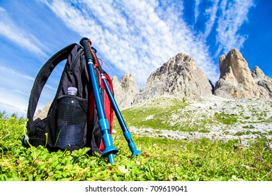 Backpack and hiking poles, for trekking in the Alps