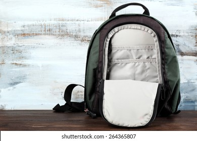 Backpack on wooden background