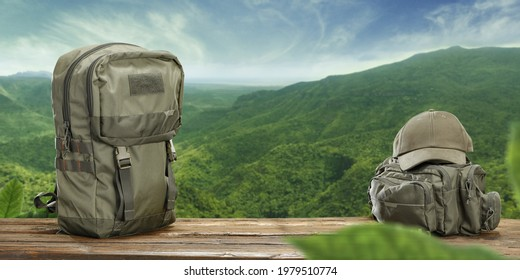 Backpack on wooden desk and free space for your decoration. Summer landscape and sunny warm day.