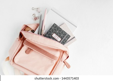 Backpack with school supplies and books for study. Back to school concept. Flat lay, top view