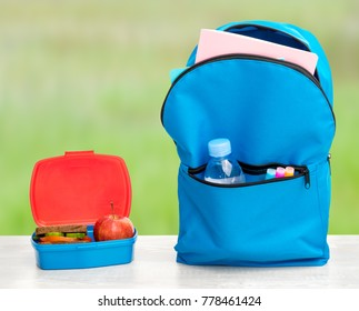 Backpack with school supplies and lunchbox