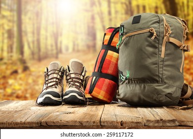 backpack shoes and forest of sun light