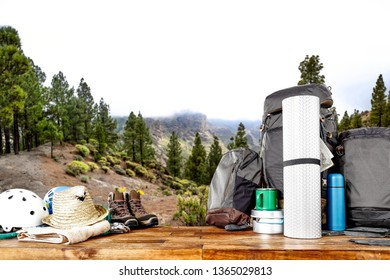 Backpack and summer trip in mountains. Wooden table of free space for your decoration.