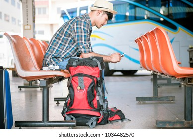 backpack young man traveler wait at the bus station. Travel concept.