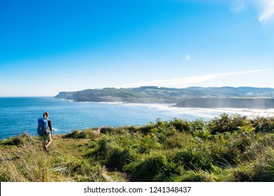 Backpacker in beautiful nature in the north of Spain. Walking Camino Norte, one of the Caminos de Santiago.