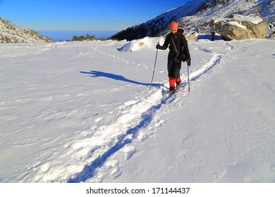 Backpacker in deep snow on the mountain