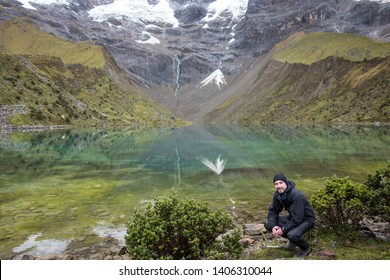 Backpacker in front of the Humantay Lake on the Salkantay Trail, the trek to Machu Picchu, Peru