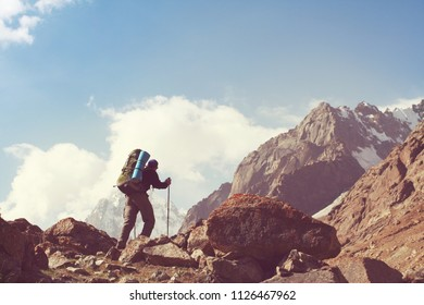 Backpacker in high beautiful mountains