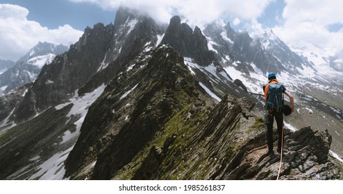 Backpacker hiking up Chamonix Alps in France
