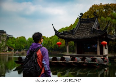 A backpacker looking at the pavillion on the lake